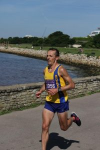 Jacek Cieluszecki powers along in Poole Half Marathon