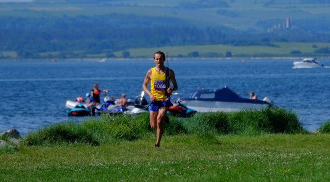 Jacek Cieluszecki by water in Poole Half Marathon