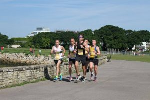 Josh Cole in pack in Poole 10k