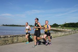 Josh Cole by wall in Poole 10k