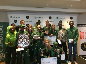 Nedbank team with trophies in Comrades Marathon