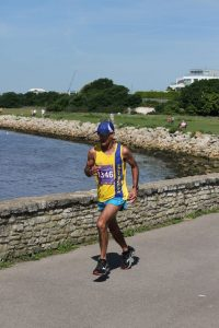 Sanjai Sharma by wall in Poole Half Marathon