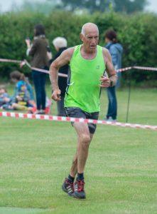 Simon Hunt finishing the Bredon Cricket Club Tower Run