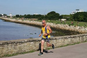 Simon Hunt by wall in Poole 10k