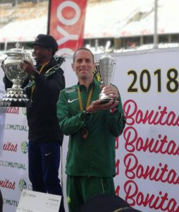 Steve Way with 3rd place trophy in Comrades Marathon