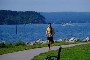 Tom Paskins by the water in the Poole Half Marathon