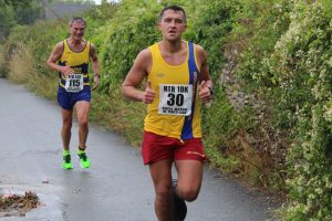 Andrew Brookes finishing the Round the Rock 10k