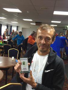 Jacek Cieluszecki with 1st M40 trophy in Round the Rock 10k
