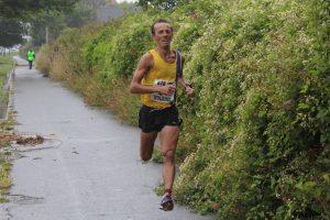 Jacek Cieluszecki finishing the Round the Rock 10k