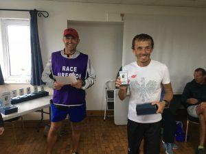 Jacek Cieluszecki gets prize for 2nd male in Round the Rock 10k