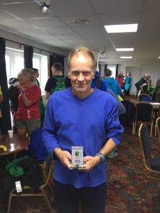 Jud Kirk with 1st M60 trophy in Round the Rock 10k