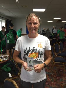 Julia Austin with 1st F50 trophy in Round the Rock 10k