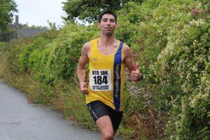 László Tóth finishes the Round the Rock 10k