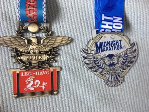 Medals from both the Dorset Invader and Midnight Marathons