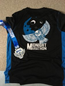 Medal and t-shirt from the Midnight Marathon