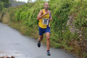 Rich Brawn finishes the Round the Rock 10k
