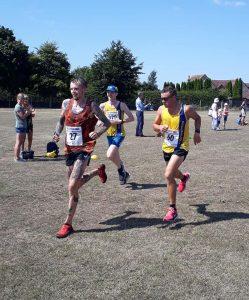Sean Edwards, Craig Palmer and Dave Long near the finish