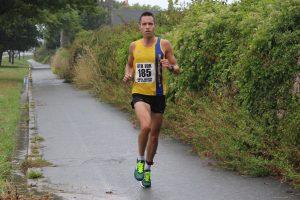 Stu Nicholas finishes the Round the Rock 10k