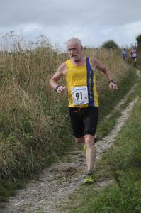 Andy Gillespie makes his way round the Great Wishford 10k course