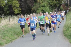 Andy Gillespie in the thick of it at the Great Wishford 10k