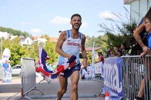 Ant Clark crosses the line in 100k World Championships