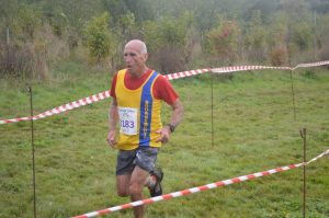 Simon Hunt crosses the line in the Black Hill 10k