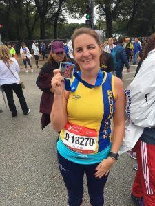 Caroline holds medal aloft after Chicago Marathon