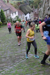 Helen Ambrosen climbs up Gold Hill
