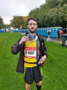 Tom Paskins with medal after Chicago Marathon