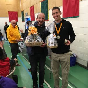 Stu Nicholas collects his prize for 3rd place in Cornish Marathon
