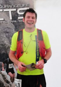 Ollie Stoten looks pleased after completing the CTS Dorset Half Marathon