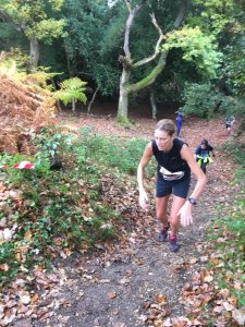 Emma Caplan climbs a hill in the Maverick inov-8 New Forest
