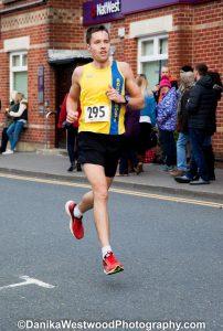 Stu Nicholas runs past in the Broadstone Quarter