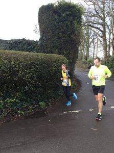 Tamzin Petersen going round the corner in the Lytchett 10