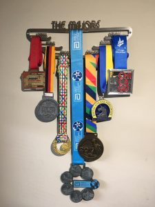 Caroline Rowley's World Marathon Major medal rack