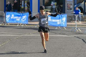 Jacek Cieluszecki comes in the the win at the Weymouth Half Marathon