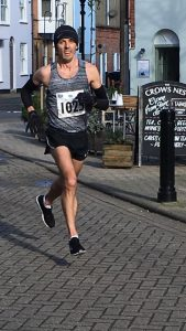 Jacek Cieluszecki powers along in the Weymouth Half Marathon