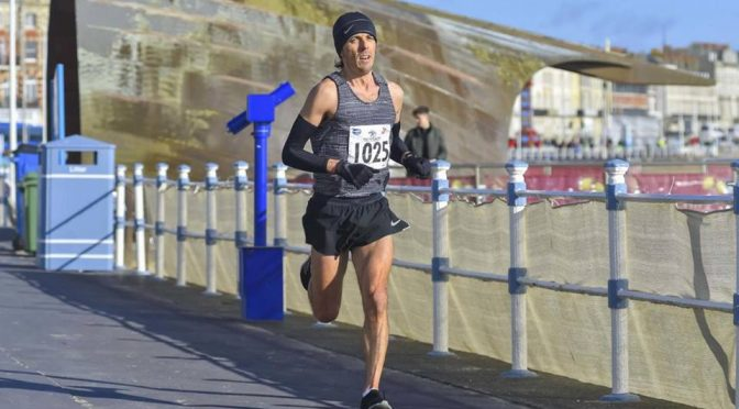 Jacek Cieluszecki surges on in the Weymouth Half Marathon