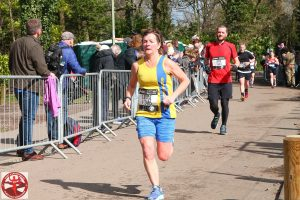 Louise Price finishing the Fleet Half Marathon
