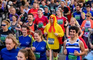 Man dressed as a rooster in the Bath Half Marathon