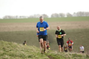 Rob Spall reaches the top of the hill in the Larmer Tree 10