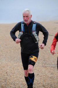 Andy Gillespie makes his way across the beach on day 2 of the Jurassic Coast Challenge