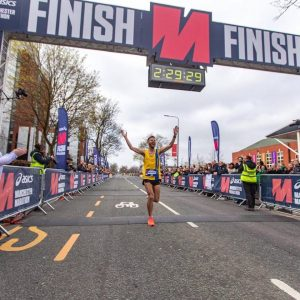 Ant Clark finishes the Manchester Marathon