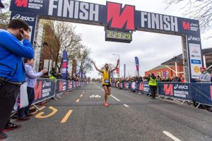 Ant Clark finishing the Manchester Marathon
