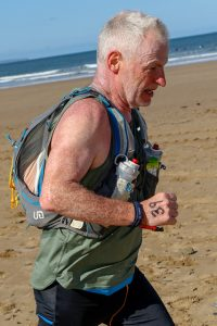 Andy Gillespie makes his way across the sand in the Devon Coast Challenge