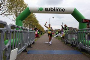 Emma Caplan reaching the line in the Peterborough Marathon