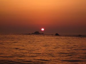 The sun sets at the end of the Guernsey Easter Run weekend
