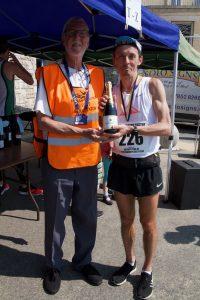 Jacek Cieluszecki collects his prize for winning the Easter Quarter Marathon