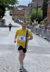 Julian Oxborough approaches the finish of the Glastonbury Round the Tor 10k