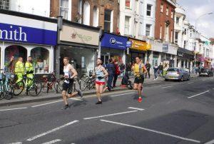 Stu Nicholas presses on in the Brighton Marathon